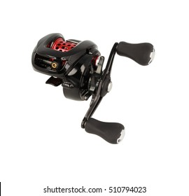 Multiplier fishing reel on white background. Fishing equipment. Close up.