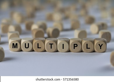 multiply - cube with letters, sign with wooden cubes