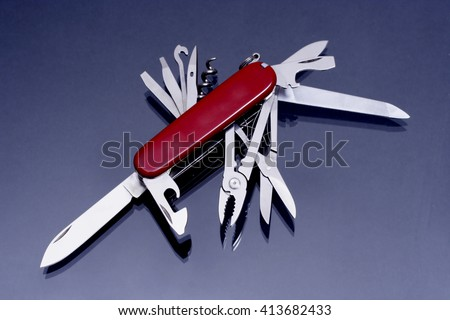 Multipurpose Knife On Dark Background Stock Photo Edit