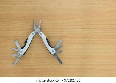 multipurpose pocket knife on wood background