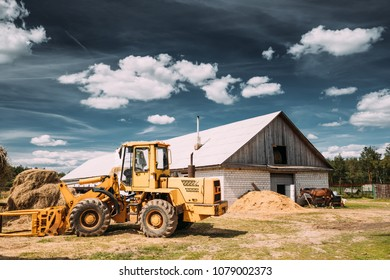 Multipurpose Wheel Loader Carry Out Works In Transportation Of Hay In Agruculture Place In Summer Sunny Day. Special Agricultural Equipment.