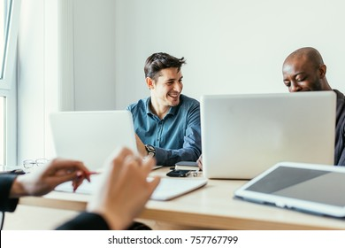 Multiracial business people working together connected with technological devices like tablet and notebook - teamwork, business, working concept