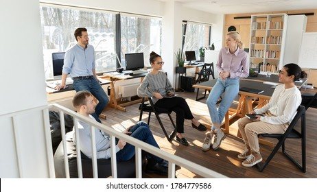 Multiracial businesspeople gather in office brainstorm discuss business project or idea together, diverse colleagues coworkers talk engaged in teambuilding activity at meeting or briefing in boardroom