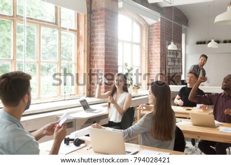Multiracial corporate team launching paper planes in coworking office interior, diverse employees group laughing having fun at work, lazy workers wasting time, startup concept, career dreams hopes