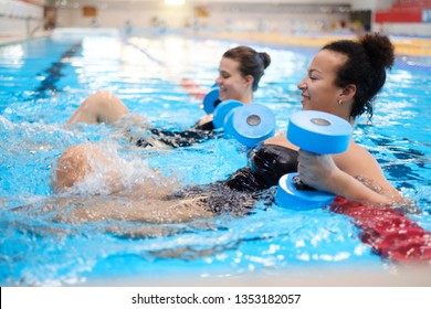 Multiracial couple attending water aerobics class in a swimming pool