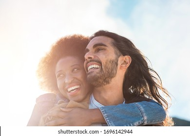 Multiracial couple having tender moments outdoor - Caucasian man and african woman having fun together during vacation - Travel, love and multi thnic relationship concept - Focun on faces