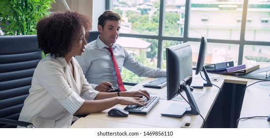 Multiracial  creative people in modern office.Businessman are working together with Female employee discuss work and think about solutions to problems, study work processes at work desks  - Shutterstock ID 1469856110
