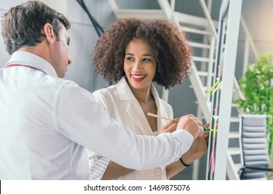 Multiracial creative people in modern office.Businessman are working together with Female employee discuss work and think about solutions to problems, study work processes at work desks