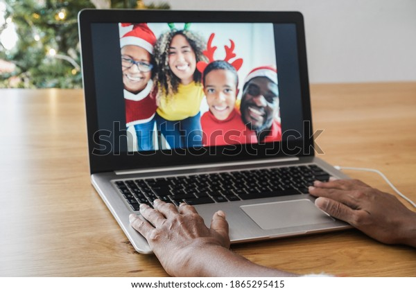 Multiracial family doing video call during Christmas time - Soft focus on left hand