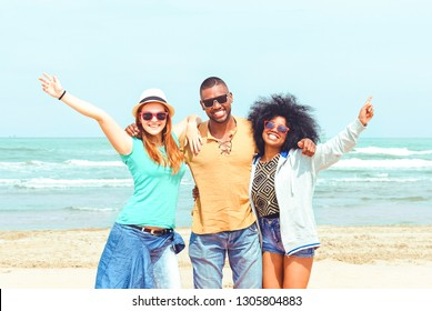 Multiracial friends having fun at the beach party - Happy people hands up looking at camera smiling on sunny day in joyful moment together - Concept of students spring vacation , weekend break - image