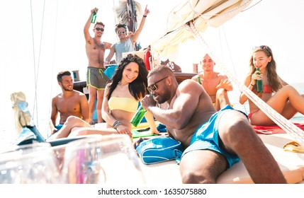 Multiracial friends having fun at sailboat party with dj set - Wanderlust travel concept with young people on sailing trip - Luxury lifestyle on exlusive summer mood - Warm sunshine halo filter