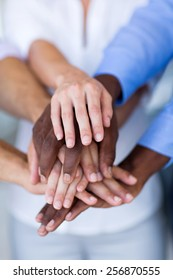 multiracial group of business people hands together
