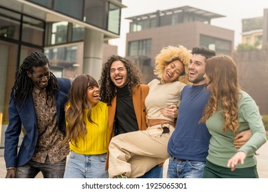 multiracial group of friends walking and having fun together, millennials people smiling and laughing in city context, social diversity people from the world