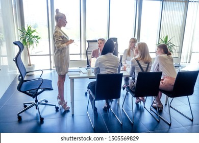 multiracial group of young women editor of famous magazine collaborating in open space office in a modern office with panoramic windows