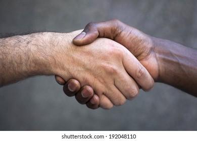 Multiracial handshake. Isolated on white.