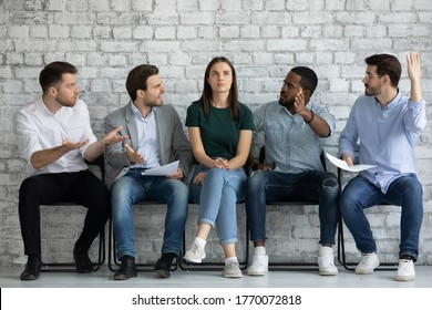 Multiracial men applicants sit on chairs in job interview queue show disrespect for girl kick out her. Disregard neglect, gender discrimination of women in business and professional occupation sphere