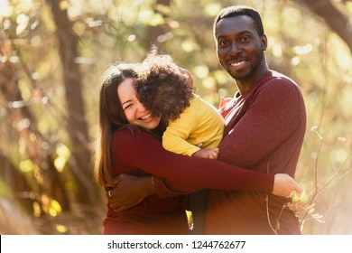Multiracial mixed family concept. Black father and white mother