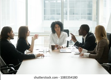 Multiracial people having dispute about bad document at group meeting, african businessman disagreeing with contract terms at multi-ethnic negotiations in lawyers office, fraud or legal fight concept