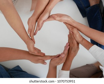 Multiracial people together are making hands circle Symbol of teamwork and friendships