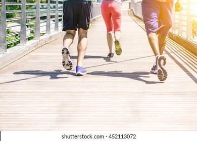 Multiracial runners doing jogging on city contest with sunset - Fitness people training outdoors for a healthy lifestyle - Concept of athlete running for sport competition - Warm vintage filter