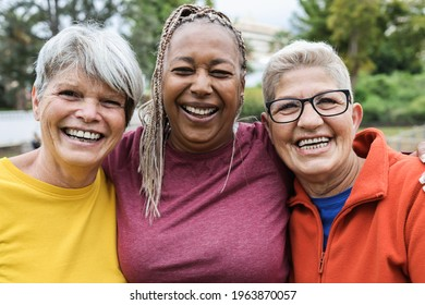 Multiracial senior women having fun together after sport workout outdoor - Main focus on right female face