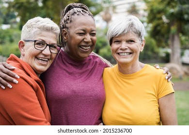 Multiracial senior women having fun together after sport workout outdoor - Focus on left female face