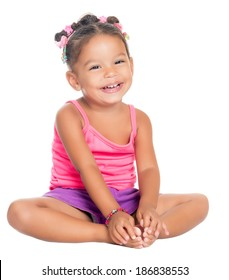 Multiracial small girl laughing sitting on the floor (isolated on white)