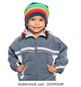 Multiracial small girl wearing a jacket and a colorful beanie hat isolated on white