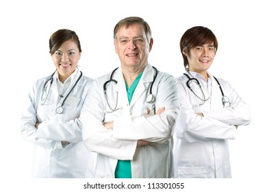 Multiracial team of doctors wearing a white coats with stethoscope's. Isolated on white.