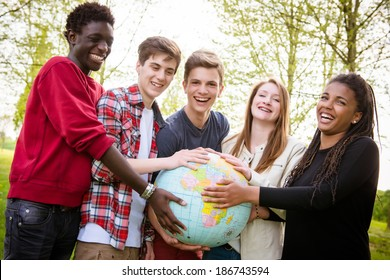 Multiracial Teen Couple Holding Globe Map - stock