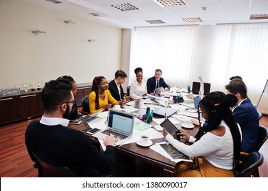 Multiracial young creative people in modern office. Group of young business people are working together with laptop, tablet. Successful freelancers team in coworking.