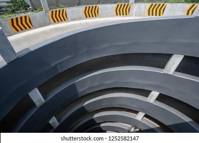 multi-storey car parking. Circular ramp in the multi Level parking garage, Top view.