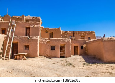 Multi-story adobe buildings from Taos Pueblo in New Mexico where Indigenous people are still living after over a thousand years