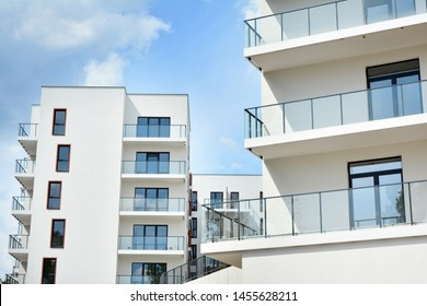 Multistory new modern apartment building. Stylish living block of flats.