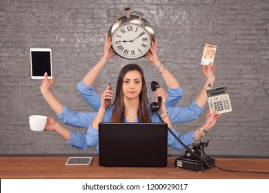 multitask businesswoman sat at the desk in the office, concept of well organized work