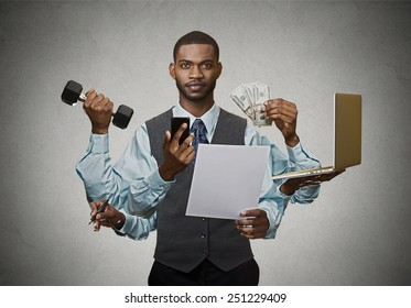 Multitasking business man isolated on grey wall background. Busy life of company manager corporate executive. Many errands concept