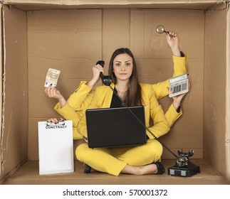 multitasking businesswoman siting in the box office