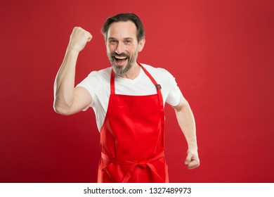 Multitasking is chefs game. Cook with beard and mustache red background. Man mature cook posing cooking apron. Fine recipe. Ideas and tips. Chief cook and professional culinary. Cook food at home.
