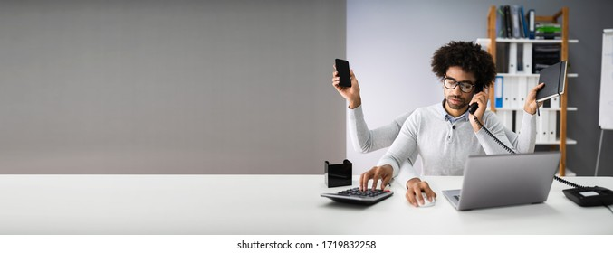 Multitasking Workload Of Happy Busy Man Worker In Office