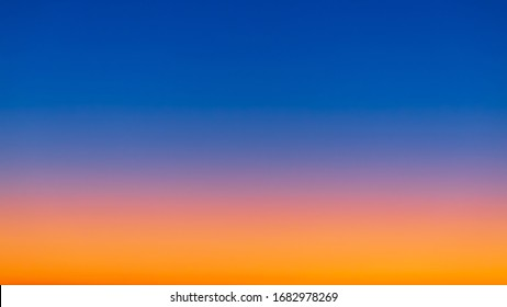 Multitude of colors at sunrise from bright yellow and orange near the horizon to deep blues higher in the atmosphere