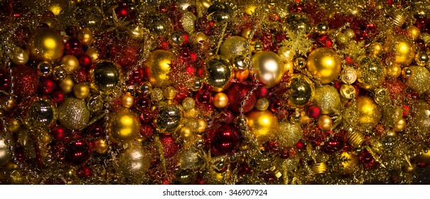 A multitude of golden and red christmas decorations