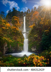 Multnomah Falls in Autumn foliage colors with shining sun