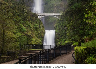 Multnomah Falls with bridge over falls and walkway and railings leading to lower viewpoint in state of Oregon's Columbia Gorge