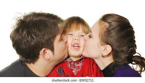 Mum and the daddy kiss the son. It is isolated on a white background