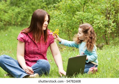 Mum with the daughter on the nature