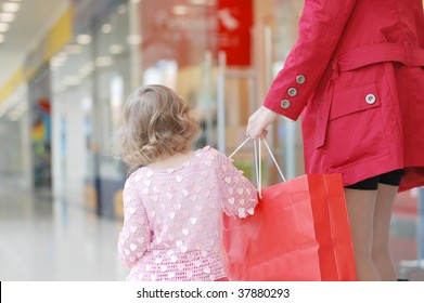 Mum and daughter in shopping centre