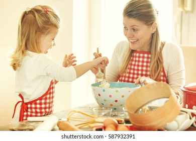 Mum and daughter spending time together making dough.