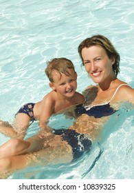 Mum with the son in pool of an aquapark