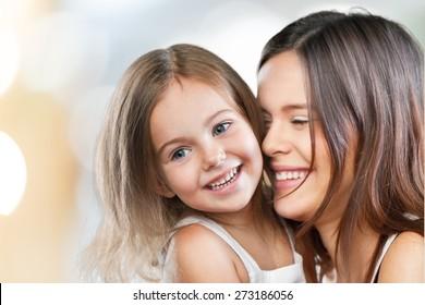 Mum, teeth, hugging.