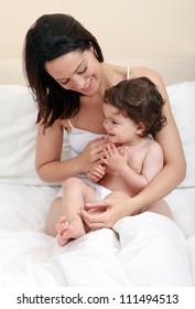 Mum tickling baby - happy family